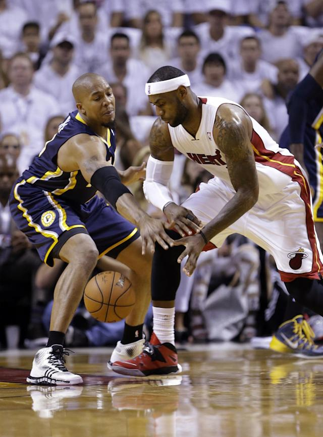Indiana Pacers forward David West , left, blocks a pass by Miami Heat forward LeBron James during the first half of Game 4 in the NBA basketball Eastern Conference finals playoff series, Monday, May 26, 2014, in Miami. (AP Photo/Wilfredo Lee)