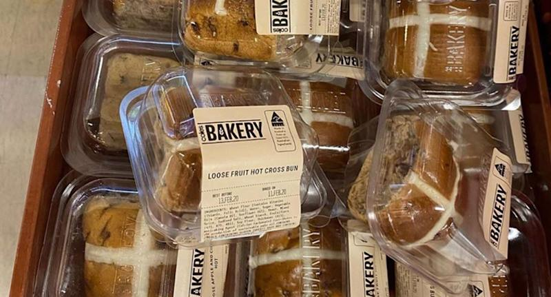 Coles supermarket selling loose hot cross buns in plastic packaging.