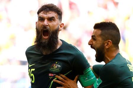 Soccer Football - World Cup - Group C - Denmark vs Australia - Samara Arena, Samara, Russia - June 21, 2018 Australia's Mile Jedinak celebrates scoring their first goal REUTERS/Michael Dalder