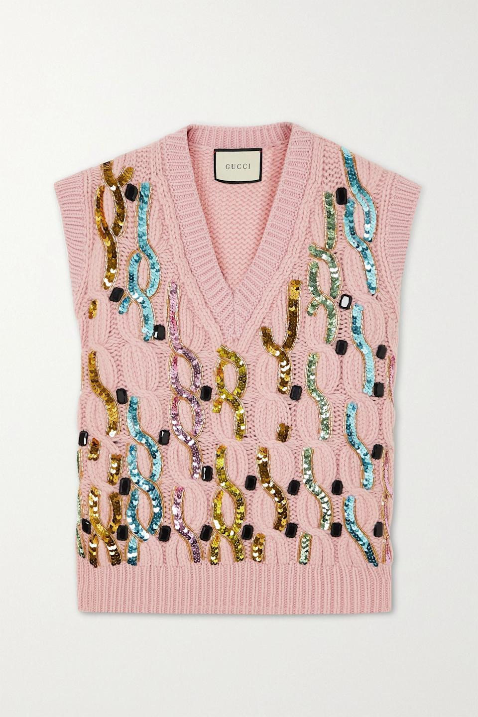"""<p><strong>Gucci</strong></p><p>net-a-porter.com</p><p><strong>$1800.00</strong></p><p><a href=""""https://go.redirectingat.com?id=74968X1596630&url=https%3A%2F%2Fwww.net-a-porter.com%2Fen-us%2Fshop%2Fproduct%2Fgucci%2Fembellished-cable-knit-wool-vest%2F1255387&sref=https%3A%2F%2Fwww.townandcountrymag.com%2Fstyle%2Ffashion-trends%2Fg34521550%2Fbest-sweater-vests%2F"""" rel=""""nofollow noopener"""" target=""""_blank"""" data-ylk=""""slk:Shop Now"""" class=""""link rapid-noclick-resp"""">Shop Now</a></p>"""