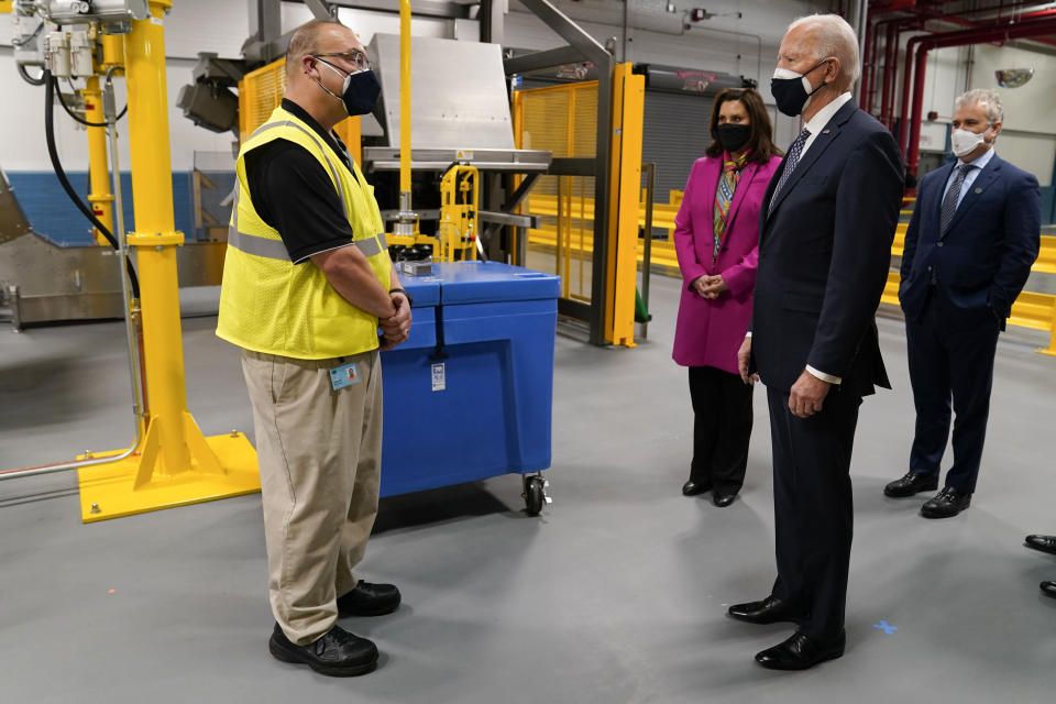 President Joe Biden, Michigan Gov. Gretchen Whitmer, third from right, and Jeff Zients, White House coronavirus response coordinator, right, tour a Pfizer manufacturing site, Friday, Feb. 19, 2021, in Portage, Mich. (AP Photo/Evan Vucci)