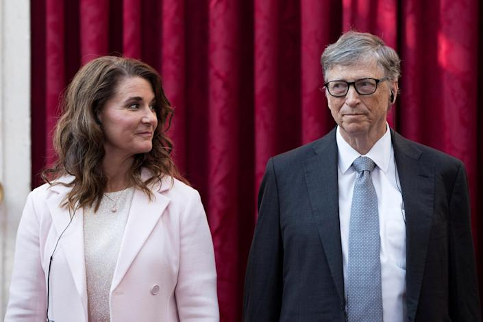 Image: Philanthropist and co-founder of Microsoft, Bill Gates and his wife Melinda listen to the speech by French President Francois Hollande, prior to being awarded Commanders of the Legion of Honor at the Elysee Palace in Paris (Kamil Zihnioglu / Pool via Reuters)