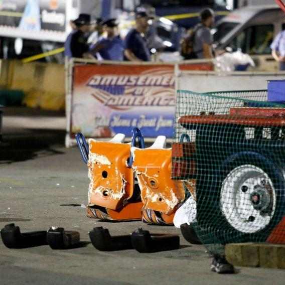<p>Damage done by the spinning Fire Ball ride that broke apart, killing one and injuring seven. (AP) </p>