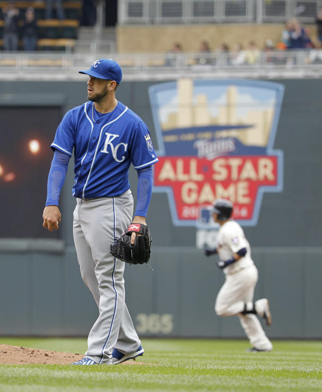 Kansas City Royals starting pitcher James Shields looks toward the outfield as Minnesota Twins' Brian Dozier rounds the bases after hitting a solo home run during the first inning of a baseball game in Minneapolis, Saturday, April 12, 2014. (AP Photo/Ann Heisenfelt)