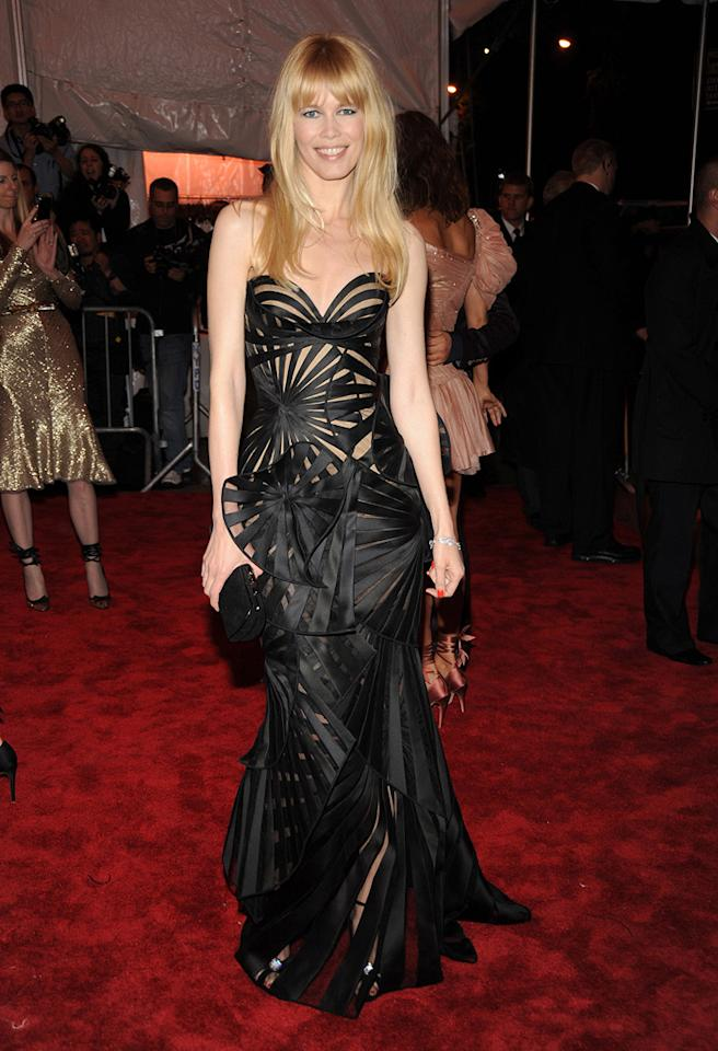 """Claudia Schiffer rocked an intricate cut-out gown by Versace. Kevin Mazur/<a href=""""http://www.wireimage.com"""" target=""""new"""">WireImage.com</a> - May 4, 2009"""