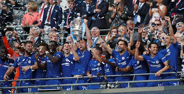 Soccer Football - FA Cup Final - Chelsea vs Manchester United - Wembley Stadium, London, Britain - May 19, 2018 Chelsea's Gary Cahill lifts the trophy as they celebrate winning the FA Cup REUTERS/David Klein