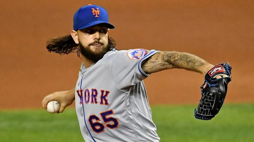 Robert Gsellman getting ready to throw a pitch in Mets' road uniform close crop