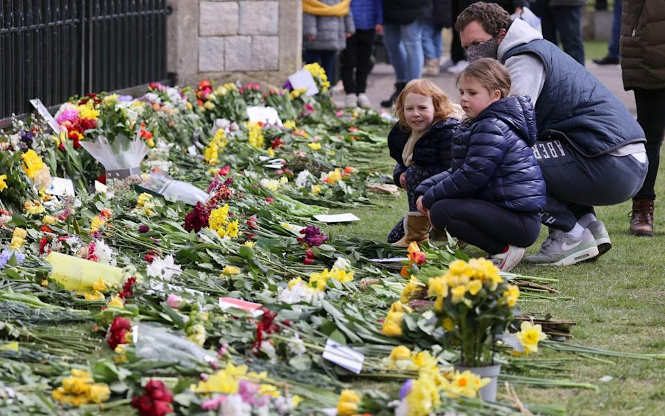 Members of the public leave floral tributes to Prince Philip, Duke Of Edinburgh who died at age 99 outside of Windsor Castle on April 11 - Chris Jackson/Getty
