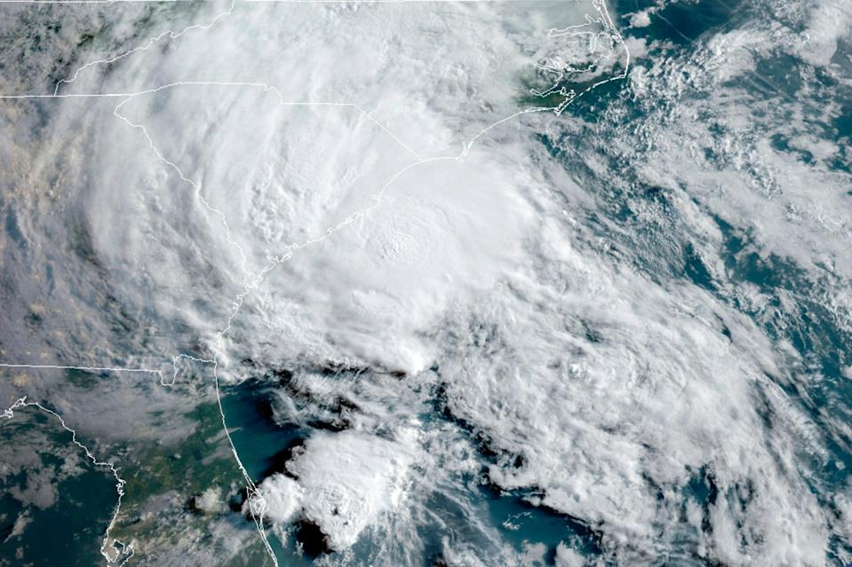 <p>This Wednesday, 27 May 2020 satellite image made available by the National Oceanic and Atmospheric Administration shows Tropical Storm Bertha approaching the South Carolina coast</p> ((Associated Press))