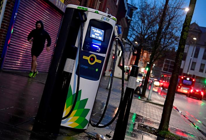 A man runs past a BP (British Petroleum) EV (Electric Vehicle) charge point in London, Britain, January 30, 2021. (Toby Melville/Reuters)