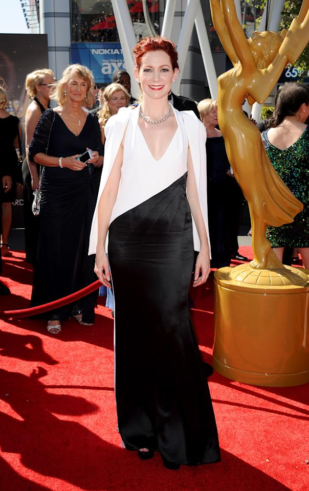 Carrie Preston arrives at the 2013 Primetime Creative Arts Emmy Awards, on Sunday, September 15, 2013 at Nokia Theatre L.A. Live, in Los Angeles, Calif. (Photo by Scott Kirkland/Invision for Academy of Television Arts & Sciences/AP Images)