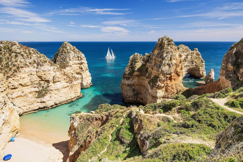 """<p>Portugal is known for its non-habitual residence tax regime (NHR), also called <a href=""""https://www.goldenvisas.com/portugal"""" rel=""""nofollow noopener"""" target=""""_blank"""" data-ylk=""""slk:Portugal's Golden Visa"""" class=""""link rapid-noclick-resp"""">Portugal's Golden Visa</a>, which uses tax perks to attract foreign nationals. In this case, any expats who invest in a Portugal property of $422,705 or more (on January 1, 2022, the sum increases to $603,865 or more) will receive a two-year residency permit for themselves and their immediate family. It also includes a tax-exemption on most foreign income—including pensions, dividends, and real estate investments—for up to 10 years. You can renew the visa every two years, as long as you spend at least two weeks in the country during that time span.</p> <p>Another great option for both retirees and semi-retirees is Portugal's <a href=""""https://www.globalcitizensolutions.com/portugal-d7-visa/"""" rel=""""nofollow noopener"""" target=""""_blank"""" data-ylk=""""slk:D7 Passive Income Visa"""" class=""""link rapid-noclick-resp"""">D7 Passive Income Visa</a>. This popular residency program includes the option to become a non-habitual resident (and reap the aforementioned tax benefit), as well as the ability to actually work while there, whether it's living life as a digital nomad or being employed at a Portuguese-run business. It even allows access to the country's extensive healthcare system. The visa is valid for two years, and then can be renewed for three more. Five years in, you can apply for permanent citizenship. </p> <p><strong>Requirements:</strong> There are no age restrictions for the D7 visa, though you must demonstrate an annual passive income of at least $9,194 (plus $4,345 per adult, and $2,606 per dependent), which is equal to the country's current minimum wage, to apply. To qualify for the Golden Visa, you can't have paid taxes in Portugal over any of the last five years.</p>"""