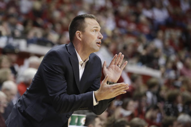 South Dakota State head coach Eric Henderson encourages his team during the first half of an NCAA college basketball game against Indiana, Saturday, Nov. 30, 2019, in Bloomington, Ind. (AP Photo/Darron Cummings)