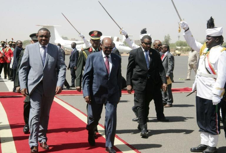 Red carpet: Former prime minister Halemariam Desalegn, left, on a visit to Khartoum in 2015 alongside Sudan's now-ousted leader, Omar al-Bashir