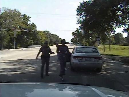 Texas state trooper Brian Encinia points a Taser as he orders Sandra Bland out of her vehicle, in this still image captured from the police dash camera video from the traffic stop of Bland's vehicle in Prairie View, Texas, July 10, 2015. REUTERS/The Texas Department of Public Safety/Handout via Reuters