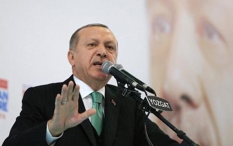 Turkey's President Recep Tayyip Erdogan talks to supporters of his ruling Justice and Development Party (AKP), at a rally in Yozgat, eastern Turkey. - Credit: Presidency Press Service