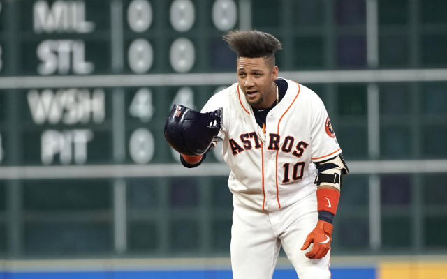 Houston Astros' Yuli Gurriel tips his helmet toward the dugout after hitting a two-run double against the Detroit Tigers during the first inning of a baseball game Monday, Aug. 19, 2019, in Houston. (AP Photo/David J. Phillip)