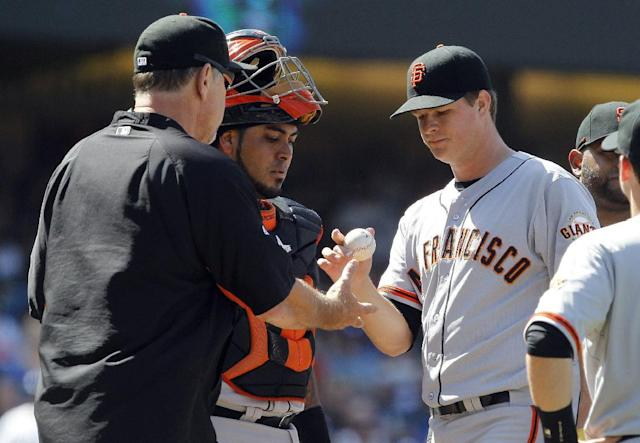 San Francisco Giants starting pitcher Matt Cain, right, is removed as he gives the baseball to manager Bruce Bochy, left, as catcher Hector Sanchez, center, watches the transaction in the sixth inning of a baseball game against the Los Angeles Dodgers, Saturday, May 10, 2014, in Los Angeles. (AP Photo/Alex Gallardo)