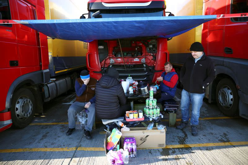 Lorry drivers from Poland sit around a table at a service station on the outskirts of Dover