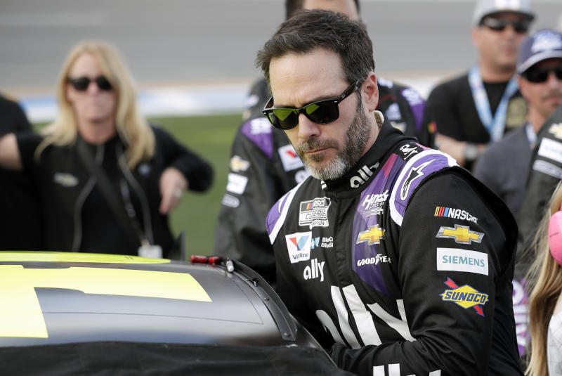 Jimmie Johnson climbs intp his car before the NASCAR Daytona 500 auto race at Daytona International Speedway, Sunday, Feb. 16, 2020, in Daytona Beach, Fla. (AP Photo/John Raoux)