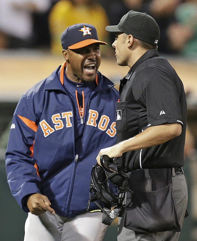 "FILE - In this Sept. 5, 2013, file photo, Houston Astros manager Bo Porter, left, yells at home plate umpire Mark Ripperger after being ejected in the eighth inning of a baseball game against the Oakland Athletics in Oakland, Calif. The Astros have fired manager Bo Porter in his second season with the club. General manager Jeff Luhnow says the decision wasn't based on Houston's record but because ""we need a new direction in our clubhouse."" The Astros entered Monday, Sept. 1, 2014, in fourth place in the AL West with a 59-79 record, second worst in the league. (AP Photo/Ben Margot, File)"