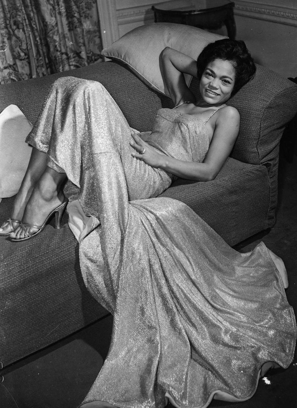 <p>The South Carolinian-born singer lounges in a trailing and sparkling evening gown and slip-on heels. </p>