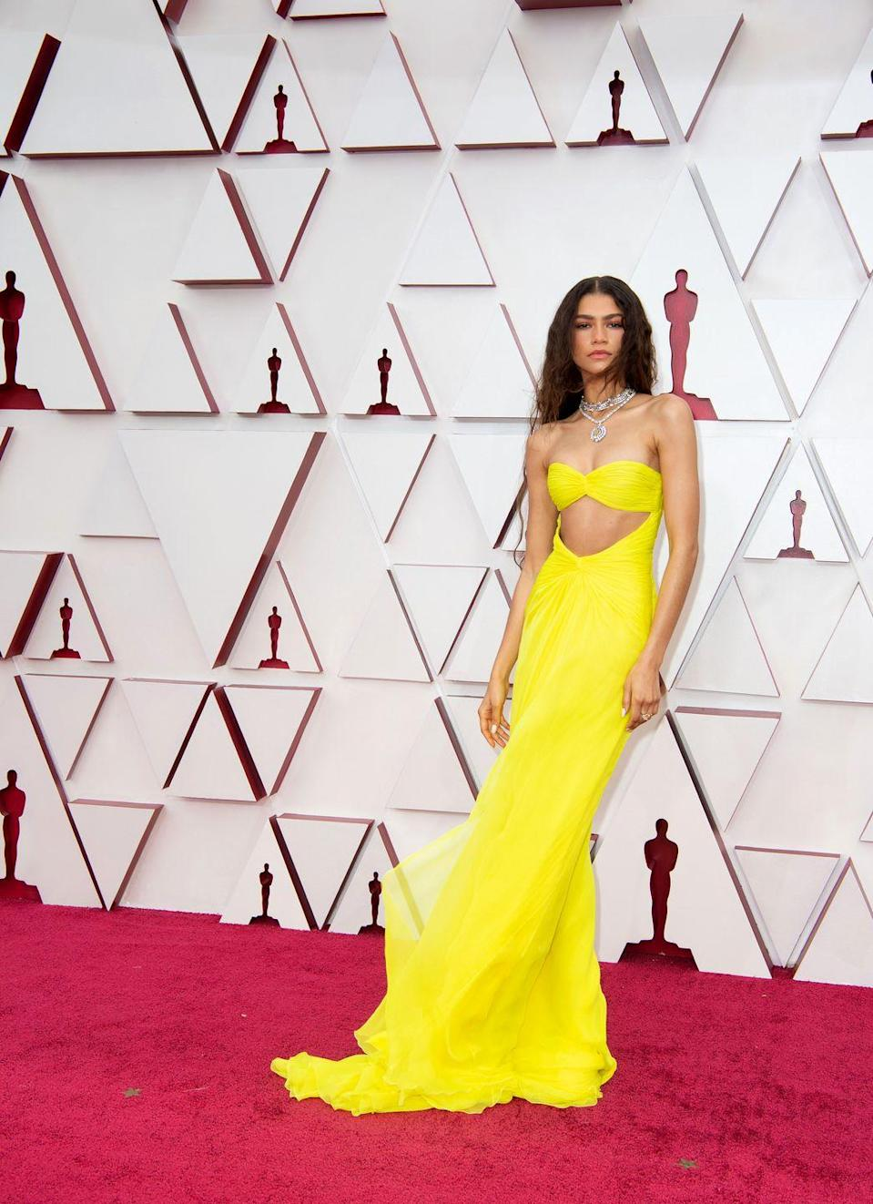 <p>Another star whose Valentino dress might just go down as one of the favourites in Oscars history was Zendaya. The star and her stylist Law Roach chose a bright yellow gown from Pier Paolo Piccioli's most recent couture collection, which also features a cut-out panel but more of a slinky silhouette than Mulligan's voluminous gown. The star also did not hold back on the bling, wearing a series of statement necklaces by Bulgari.</p>