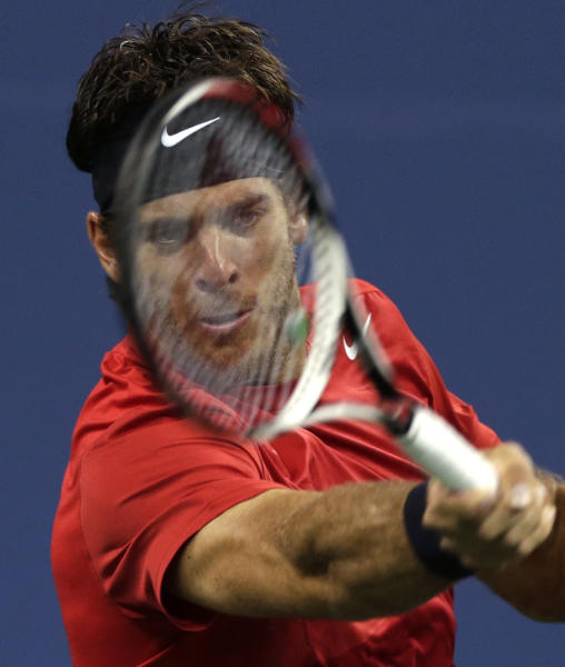 Juan Martin del Potro, of Argentina, returns to Novak Djokovic, of Serbia, during a quarterfinal of the U.S. Open tennis tournament, Thursday, Sept. 6, 2012, in New York. (AP Photo/Charles Krupa)