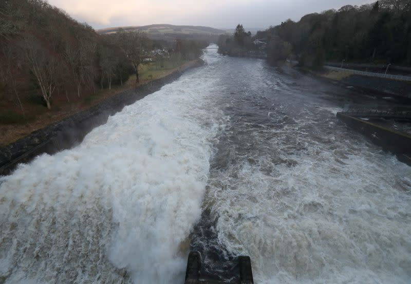 FILE PHOTO: Pitlochry Power Station releases excess capacity of water over Pitlochry Dam, part of the Tummel hydro-electric power scheme in Perthshire, Scotland