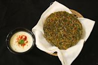 "<p>With parathas in the plate, one generally does not need anything else. Blend some spinach with coriander, ginger, garlic and cumin seeds into a puree. Combine this with wheat flour (aata), some oil, chaat masala and knead into a dough. Add water as required. Make medium size balls from the dough and roll them out like how we make chapatis / rotis. Flip them one by one on a heated tawa with oil or ghee. Savour them with some pickle and raita. ""Creative Commons Palak Paratha"" by Vsigamany is licensed under CC BY 4.0 </p>"