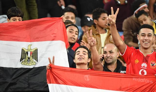 Egyptian fans cheer for their team ahead on an Africa Cup of Nations qualifier football match against Tunisia at the Borg El Arab Stadium near Alexandria on November 16, 2018 (AFP Photo/KHALED DESOUKI )