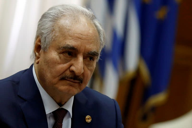 Libyan commander Khalifa Haftar meets Greek Prime Minister Kyriakos Mitsotakis (not pictured) at the Parliament in Athens