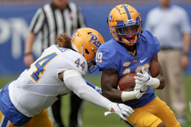 Pittsburgh running back V'Lique Carter (19) is hit by linebacker Elias Reynolds (44) on a run during their annual intrasquad Blue-Gold spring NCAA college football game, Saturday, April 13, 2019, in Pittsburgh. (AP Photo/Keith Srakocic)