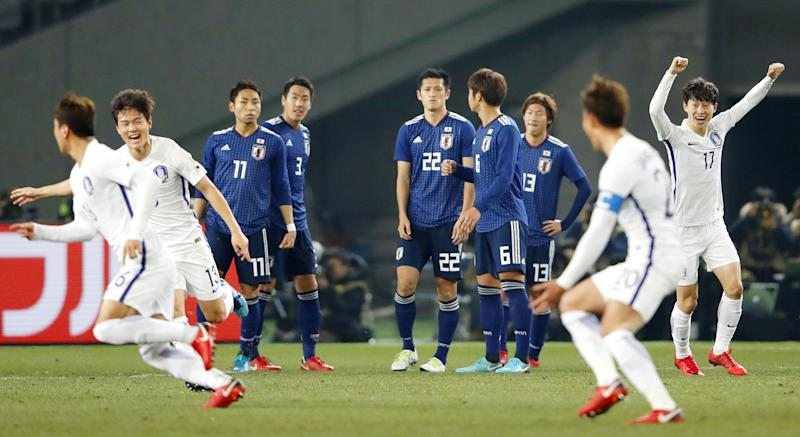 South Korea's players celebrate after scoring a goal against Japan at the East Asian Championship in Tokyo, Saturday, Dec. 16, 2017. (Fumine Tsutabayashi/Kyodo News via AP)
