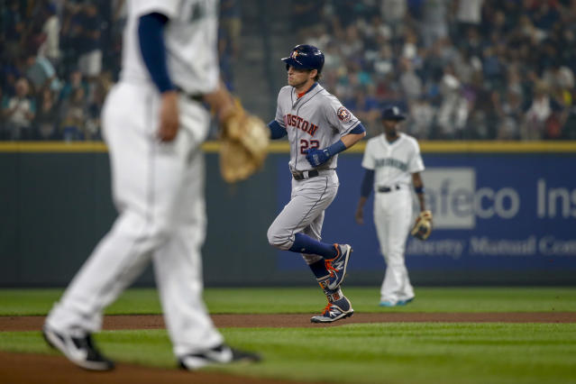 Houston Astros' Josh Reddick trots around the bases after hitting a solo home run off of Seattle Mariners pitcher Ross Detwiler during the fourth inning of a baseball game Tuesday, Aug. 21, 2018, in Seattle. (AP Photo/Jennifer Buchanan)