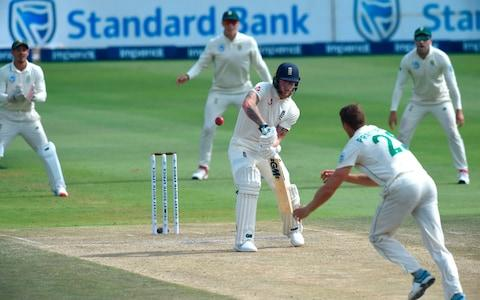 England's Ben Stokes (C) watches the ball after playing a shot delivered by South Africa's Dwaine Pretorius during the third day of the fourth Test cricket match between South Africa and England at the Wanderers Stadium in Johannesburg on January 26, 2020. - Credit: AFP