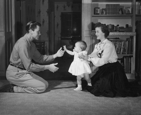 <p>Temple's first husband John Agar and Shirley spend time with their daughter Susan. </p>