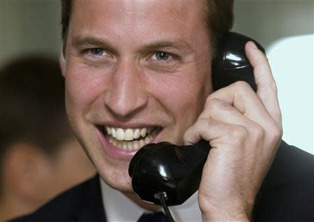Britain's Prince William takes part in a trade on the trading floor of BGC Partners in London September 11, 2013. REUTERS/Chris Jackson/pool