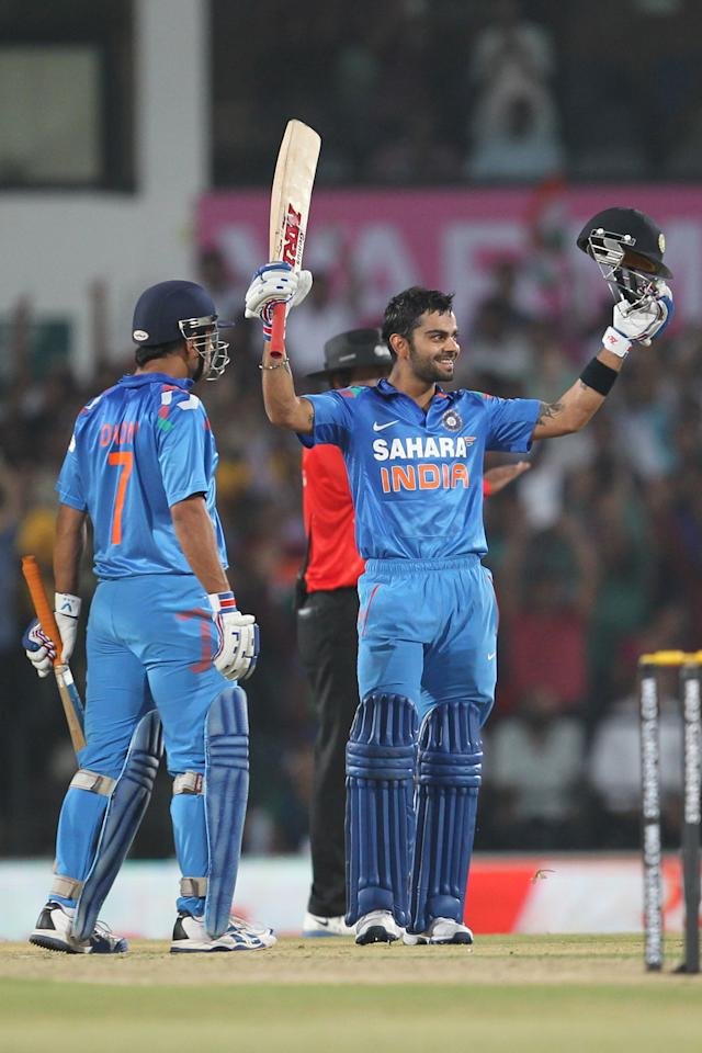 Virat Kohli celebrates century during the sixth Star Sports Series One Day International (ODI) between India and Australia held at the VIDARBHA CRICKET ASSOCIATION STADIUM, NAGPUR on the 30th October 2013