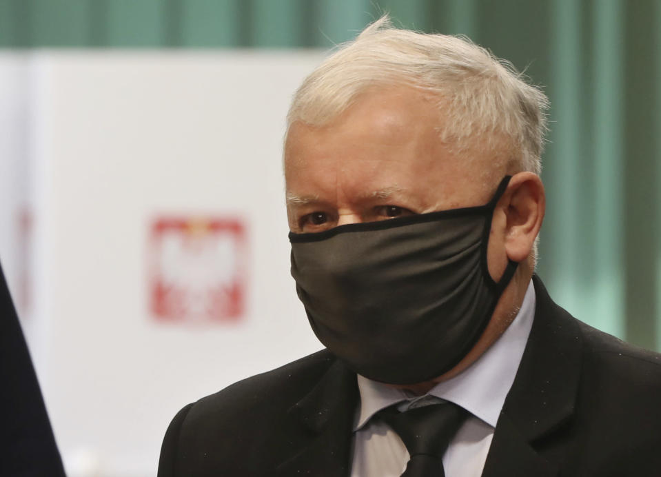 Poland's main ruling party leader Jaroslaw Kaczynski prepares to cast his vote during presidential election in Warsaw, Poland, Sunday, June 28, 2020. The election will test the popularity of incumbent President Andrzej Duda who is seeking a second term in office, and of the conservative ruling party that backs him. (AP Photo/Czarek Sokolowski)