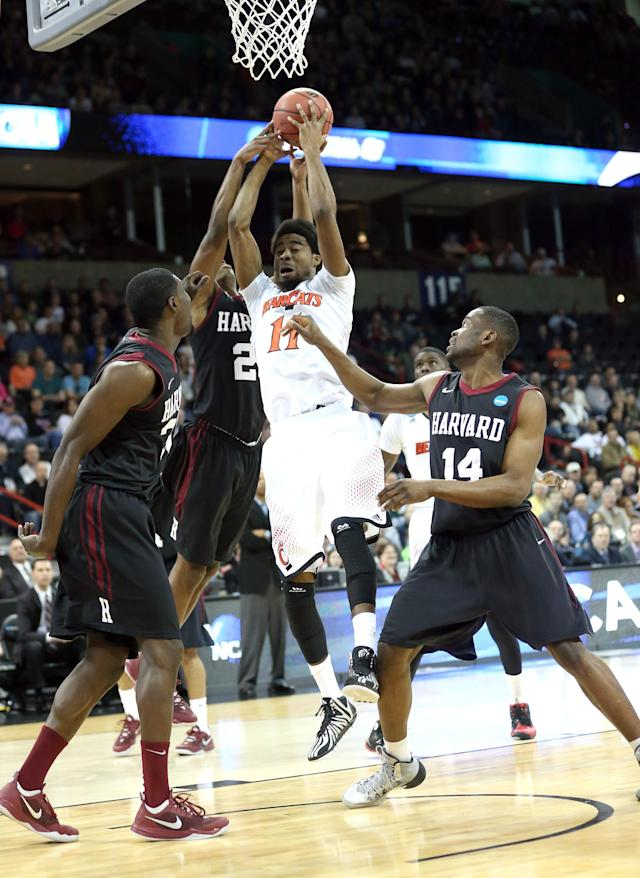 SPOKANE, WA - MARCH 20: Jermaine Lawrence #11 of the Cincinnati Bearcats goes for the ball against a group of Harvard Crimson players during the second round of the 2014 NCAA Men's Basketball Tournament at Spokane Veterans Memorial Arena on March 20, 2014 in Spokane, Washington. (Photo by Stephen Dunn/Getty Images)