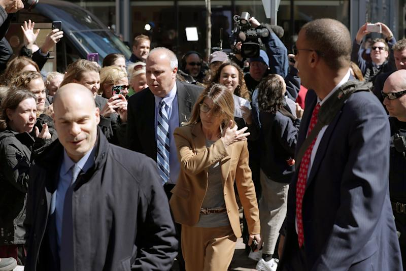 Fans photograph actress Lori Loughlin as she arrives at federal court in Boston on Wednesday, April 3, 2019, to face charges in a nationwide college admissions bribery scandal. (AP Photo/Charles Krupa)