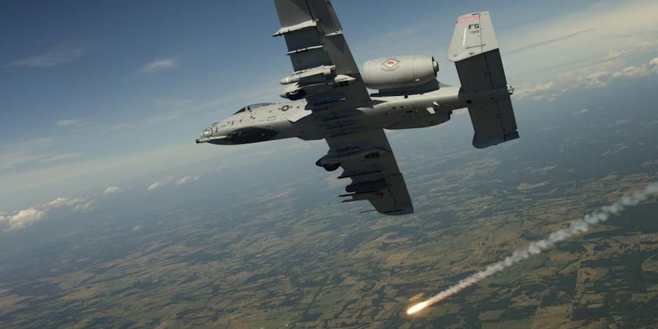 Lt. Col. Brian Burger, an A-10 Thunderbolt II pilot and the 188th Fighter Wing operations group commander, Fort Smith Air National Guard fires off a flare while banking into a high angle firing position during a training exercise on Razorback Range located at Fort Chaffee maneuver training center.