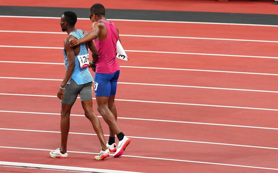 Nijel Amos and Isaiah Jewett walk to the finish line together - REUTERS