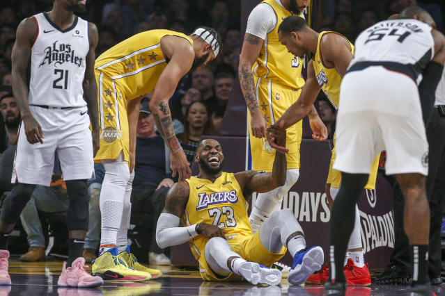 """After suffering a groin injury on Christmas, LeBron James is apparently """"on track"""" to return to the court on Saturday against the Trail Blazers. (AP/Ringo H.W. Chiu)"""