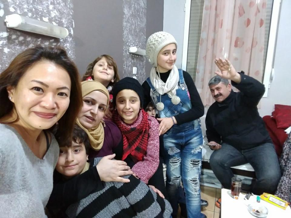 Singaporean aid worker Gabrielle Tay with a Syrian refugee family who were confined in Vial refugee camp on Chios island for 10 months, in January 2017. The family was eventually allowed to leave for Athens. PHOTO: Gabrielle Tay