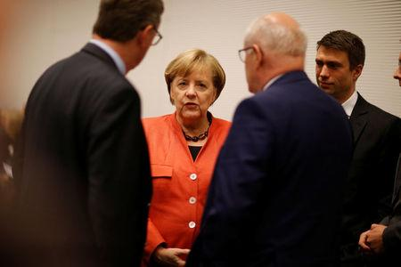 German Chancellor Merkel attends a meeting of the CDU/CSU parliamentary group at the Bundestag in Berlin