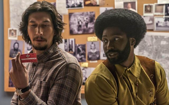 "Dir: Spike Lee Cast: John David Washington, Adam Driver, Laura Harrier, Topher Grace. Cert TBC, 128 mins Spike Lee, a fixture at Cannes early in his career but still not yet a Palme-winner, is back in competition, and blazes a righteous trail through it with BlacKkKlansman, his true-life account of a black cop in Seventies Colorado Springs who managed to get himself enrolled in the KKK. Following 2015's terrifically lively Chi-Raq and Lee's TV spin-off of She's Gotta Have It, this is yet more comeback fuel, attacking the spectre of white supremacism in America with mic-dropping aplenty, and thrusting its grievances right through the letterbox of the current White House. A heady hybrid of comedy, polemic and period crime drama, it could have been scattergun stuff, and there are patches of preachy overkill. Much more often, though, there's a rollicking drive and focus to it, which might have something to do with Jordan (Get Out) Peele's involvement in a producing capacity. Other Lee joints, like Chi-Raq and the underrated Bamboozled, have practically combusted with the fury of his satirical indignation. This one channels the same thing for populist thrills and spills: as such, it's sure to reach the biggest audience of any Lee picture since Inside Man (2006), and fully deserves to. Before the plot proper starts, Lee opens fire by excerpting the famous Atlanta train-yard triage shot from Gone with the Wind, with Vivien Leigh picking her way through the (entirely white) war wounded. Nuggets of film history pepper the movie, including the oft-cited fact that The Birth of a Nation was used as a recruitment tool to get the KKK back up and running. Meanwhile, Alec Baldwin has a fourth-wall-breaking cameo, indulgent but forgivable, as a far-right spokesperson, one Dr Kennebrew Beauregard, ranting about America's tolerance of the ""inferior race"" and not stopping at people of colour: he blames government inaction on ""the international Jewish conspiracy"" before you can even get the words ""Mel Gibson"" out. With bursts of sax from Terence Blanchard's swaggering score, we're then introduced to Ron Stallworth, played underneath a whopping afro by John David (son of Denzel) Washington. A rookie recruit in Colorado Springs' police department, he's fed up of menial duties in the records room, and pleads with his boss (an excellent Robert John Burke) to let him go undercover. So it is that he finds himself picking up the phone and kick-starting an association with the local chapter of the Klan. Still, getting down there to make a personal introduction, as a black guy, is clearly not going to fly. The real BlacKkKlansman: how a black cop infiltrated the Ku Klux Klan In steps Adam Driver, on splendidly aloof, chilled-out form as Flip, a Jewish station colleague who humours Ron more than exactly respecting him. While Ron does all the legwork over the phone, it's Flip who poses as him physically, dishing out their agreed cover story to win over all the local chapter's hick racists – well, all except Felix (a scowling Jasper Pääkönen), whose unending suspicion is going to take work. Washington, the spit of his father in the He Got Game era, gives a stoic, slow-burning, beefily charismatic performance, and undeniably owns the movie. After a stalled career in American football – slyly referenced when the cops bond over a love of OJ Simpson – stardom is very much his for the taking. Lee and his screenwriters get good comic mileage out of Ron and Flip having to sound like each other – only possible because of Ron's claim that he's simultaneously fluent in the King's English and jive. They thoroughly manage to fool KKK Grand Wizard David Duke (an amusingly lightweight Topher Grace), who's pointedly equated throughout with Trump, even dropping soundbites about making America great again. I, Tonya's Paul Walter Hauser has another plum redneck role, too, as Ivanhoe, the chapter's most egregiously thick member. The stupidity of these clowns makes them very easy targets, but Lee unshamedly claps them in the stocks, along with every wielder of the N word – some wearing police badges – he can get his hands on. The movie gets cathartic kicks out of its undercover-brother attitude, all hepcat style – Shaft meets Superfly – with a Black Power salute that's ready to do damage. Lee doesn't need to remind us about Trump's ""very fine people"" defence of Charlottesville's neo-Nazis, but it's very much his style to do exactly that, jumping from cross-burning on the lawn to videophone footage from the protests in 2017. Easily the most violent images in his movie, in fact, come in the form of documentary evidence that American bigotry is anything but a thing of the past. No one will race to BlacKkKlansman for new perspective, so much as a despairing overview pumped out with refreshing playfulness. It certainly doesn't prod at the uncomfortable boundaries of white liberal racism the way Get Out did – it's a more tub-thumping, straight-ahead piece of work. You get the sense of Lee building bridges more than wanting to burn them – he's even making amends. After long-standing accusations of antisemitism in his work, stretching back to the crude stereotypes in Mo' Better Blues (1990), he spends a lot of time here forging an alliance between the Washington and Driver characters, brothers united against the racial hatred of their common enemy. The film has some spotty passages, but when has it ever been otherwise with Lee? He exists to be uneven. Besides, watching him casually nail these sitting-duck targets, given all the spleen and sharp-shooting we know he's capable of, is actually very funny."