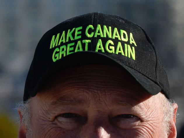 "A protester wears a ""Make Canada Great Again,"" hat as a convoy of angry Albertans and other westerners rolled up to Parliament Hill in Ottawa on Feb.19, 2019 to protest federal energy and environmental policies."