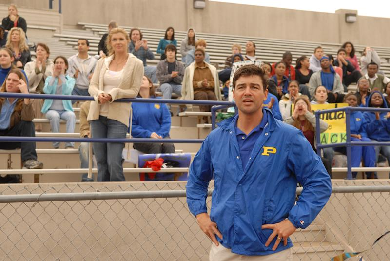 "FILE - This 2006 photo, provided by NBC Universal, shows actors Connie Britton, standing center left, as Tami Taylor, Kyle Chandler, foreground, as Eric Taylor in the NBC series ""Friday Night Lights."" Mitt Romney is giving a campaign-trail twist to an inspirational slogan from the TV series ""Friday Night Lights"" as he rides an upswing in polls after last week's debate. The coach of the football team at fictional West Dillon High School in rural Texas would build up the Panthers by saying, ""Clear eyes, full hearts, can't lose!"" ""Friday Night Lights"" aired on NBC and DirectTV over five years, ending last year, and remains a Romney favorite.  (AP Photo/NBC, Bill Records)"